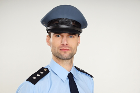 Portrait of handsome policeman, left you can write some text