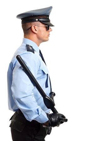 nightstick: Profile of Policeman in uniform holding in hand nightstick