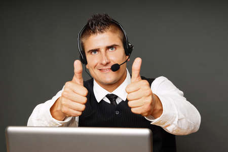 personal service: Young customer service operator shows you thumbs up Stock Photo
