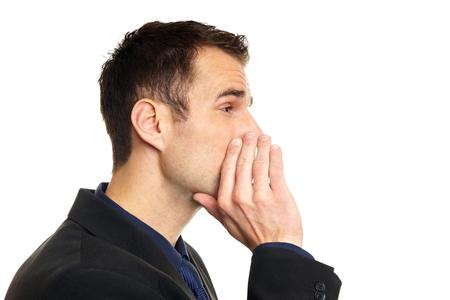 Stattlicher Mann im Anzug flüstert auf isolierte Hintergrund Standard-Bild - 29943349