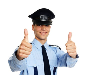 Smiling young policeman shows you thumbs up, right you can write some text photo