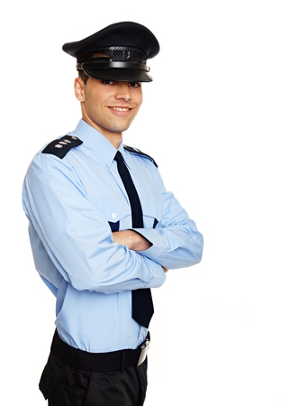 Portrait of young smiling policeman standing Archivio Fotografico