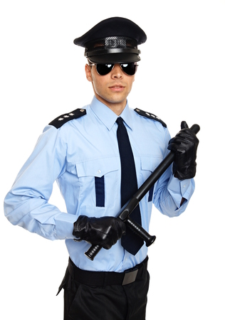 Young policemen in sunglasses and leather gloves holds nightstick