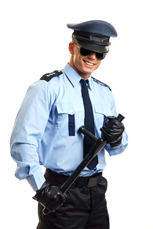 Smiling policeman in sunglasses hods nightstick photo