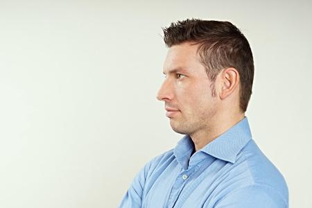 Profile of handsome man in blue shirt Standard-Bild