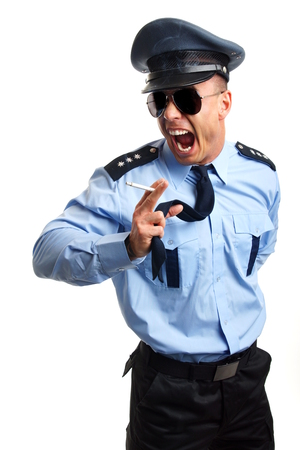 Angry policeman smoking cigarette on white background
