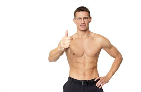 metrosexual: shirtless man shows thumb up sign on white background