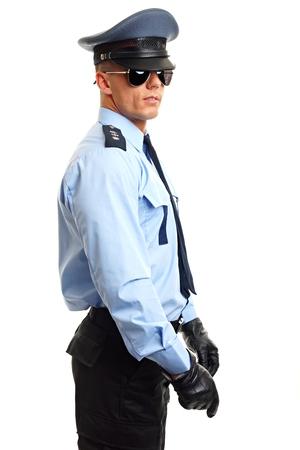 Policeman in sunglasses holds NIGHTSTICK on white background Standard-Bild