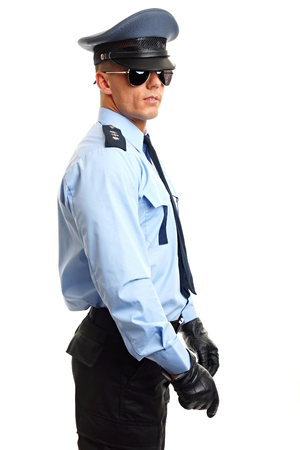 nightstick: Policeman in sunglasses holds NIGHTSTICK on white background Stock Photo