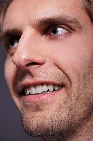 man close up: Smiling young man young man close up
