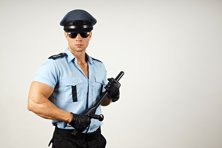 Policeman in sunglasses holds nightstick right you can write some text Standard-Bild
