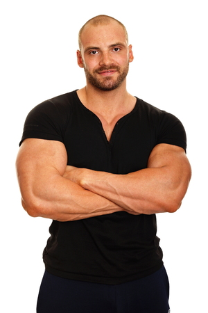 Muscular man in black shirt standing on white background