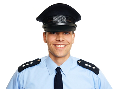 Smiling young policeman on white background