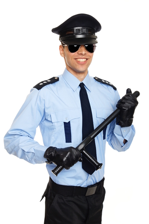 nightstick: Smiling young policeman in sunglasses holding nightstick