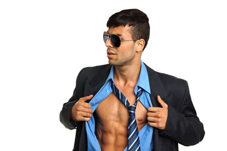 shirt unbuttoned: Young businessman in a blue shirt unbuttoned with sunglasses
