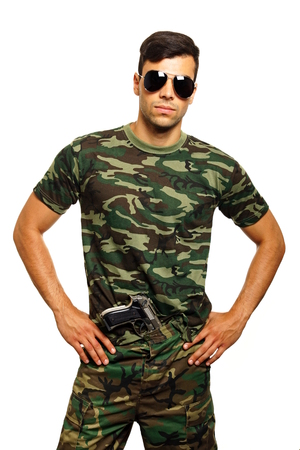 waistband: Young military man with a gun in his waistband Stock Photo