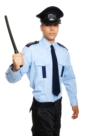 nightstick: Young policeman holding nightstick in hand