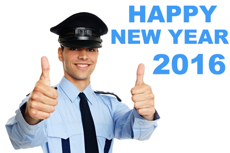 police man: Happy new year 2016 with smiling young policeman showing you thumbs up.