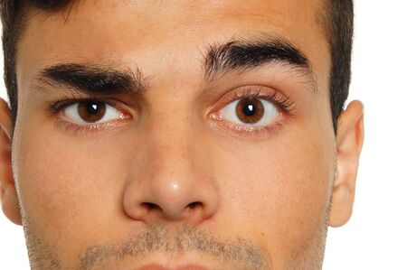 eyebrow raised: Face close-up of young man with a raised one eyebrow