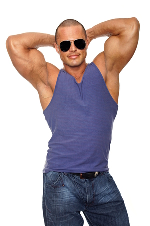 undershirt: Muscular man in a purple undershirt with sunglasses posing with hands behind head Stock Photo