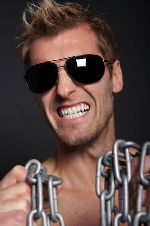 bared teeth: Crazy man with bared teeth and with a chain in his hands