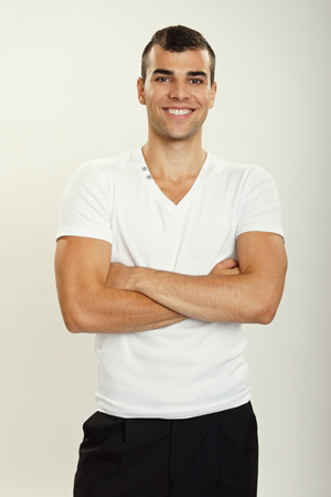 business shirt: Portrait of standing young man in white shirt