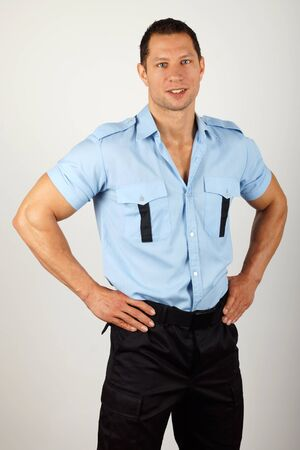 Standing smiling policeman in uniform