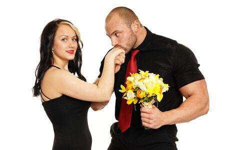 Big muscular man kissing hand of her girlfriend Standard-Bild