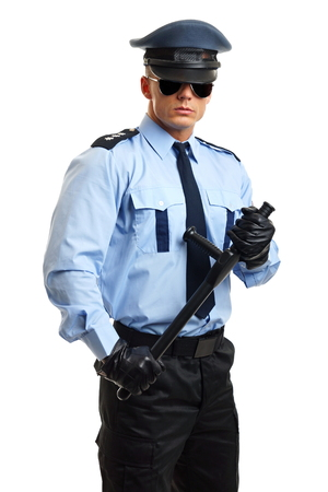 nightstick: Young policeman in uniform holds police nightstick Stock Photo
