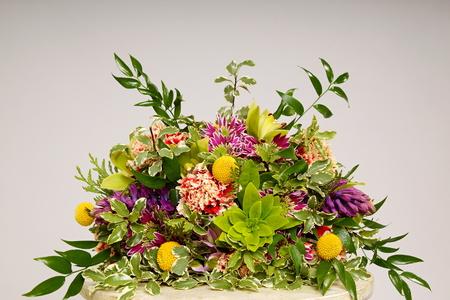 Beutiful bouquet of flowers on gray background Standard-Bild