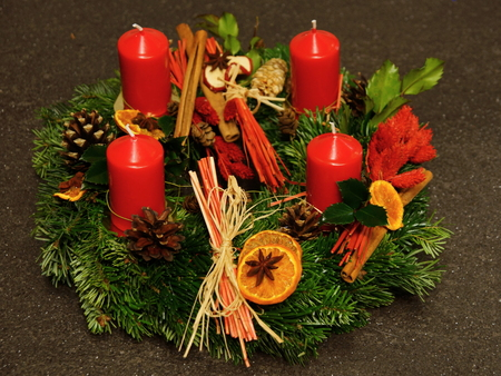 Advent decoration with four candles on gray background