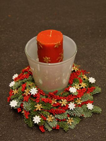 Advent wreath with orange candle in the glass