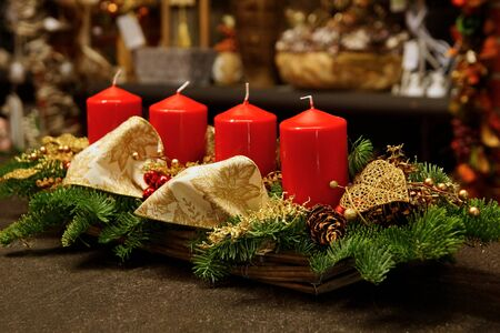 Advent decoration with four red candles with the interior on background