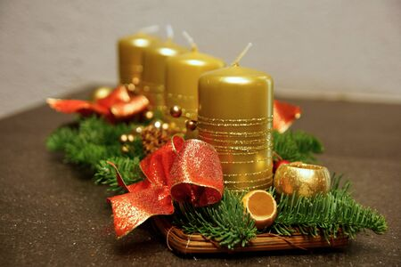Advent decoration with four gold candles on the table Standard-Bild
