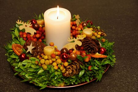 Advent wreath with burning candle on gray background Standard-Bild