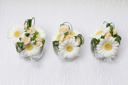 Beautiful wedding decoration with gerberas and roses over or under flowers you can write some text