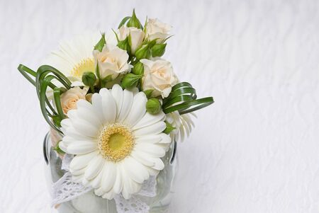 Beautiful wedding decoration with gerberas and roses, at right you can write some text Standard-Bild