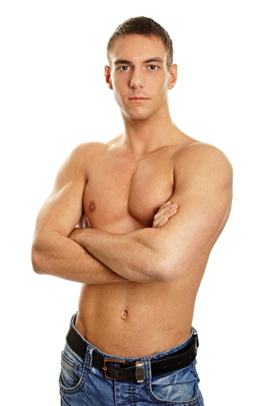 Muscular young man standing on a white background.