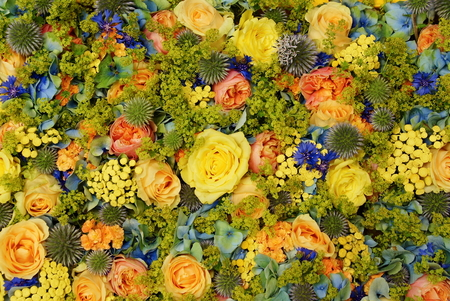 A mix of beautiful decorative flowers with roses in summer for wedding decoration