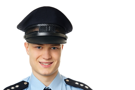 Portrait of young policeman in uniform, at right you can write some text. 스톡 콘텐츠