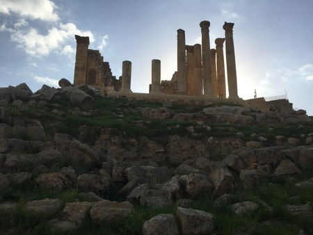 Roman ruins against a rising sun