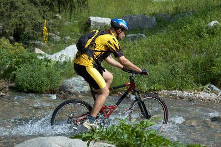 Mountain biker and creek Stock Photo - 813635