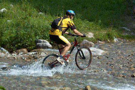 Mountain biker and creek Stock Photo