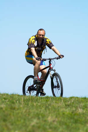 Mountain biker, sky and grass Stock Photo - 813537