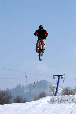 Extreme biker fly on big air photo