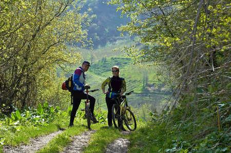 Man and woman on bike Stock Photo