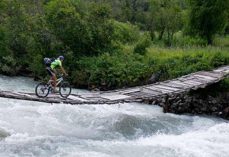 Biker on outboard bridge
