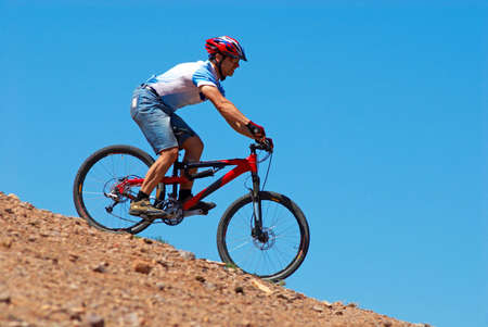 dirt road recreation: Mountain biker downhill