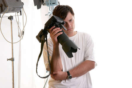 Portrait of tired photographer in studio Stock Photo