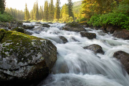 Sunrise and mountain flowing stream Stock Photo - 1379864